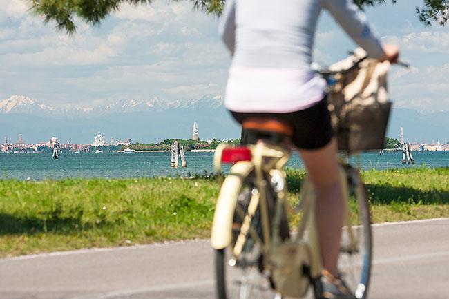 Italy, Veneto, Venezia district, Venice, Venice Lido, Venetian Lagoon, Adriatic Coast, Cycling towards Venice